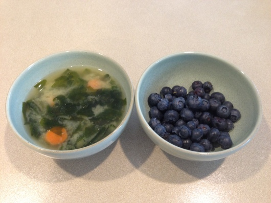 Homemade miso soup with wakame seaweed and carrots. And blueberries. Breakfast of champions!!