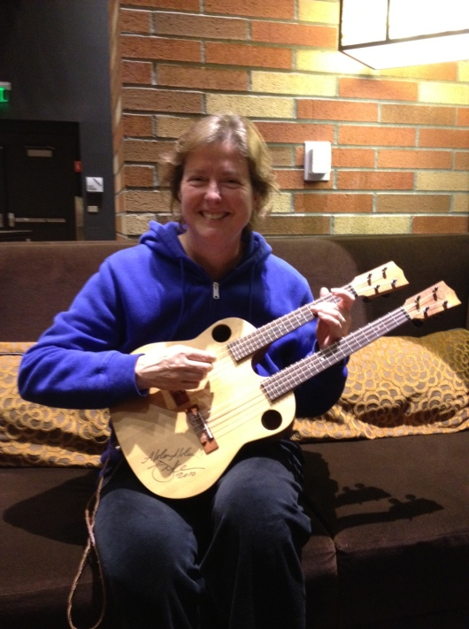Double neck mando. Top neck is strung like a ukulele. Bottom neck is strung like a viola. Cool, huh? Had a nice sound!